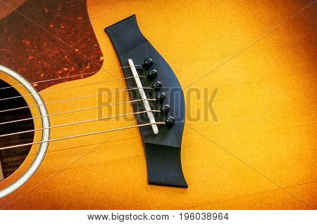 Bridge and saddle on a acoustic guitar.