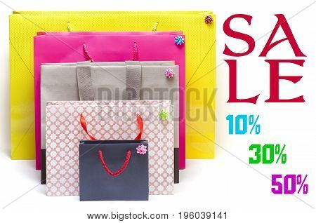 Several shopping bags and increasing sale discounts