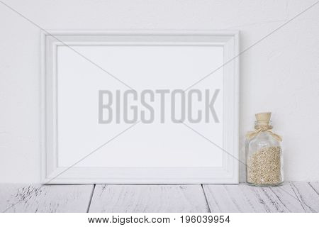 Stock Photography White Frame Vintage Painted Wood Table Glass Bottle And Sand
