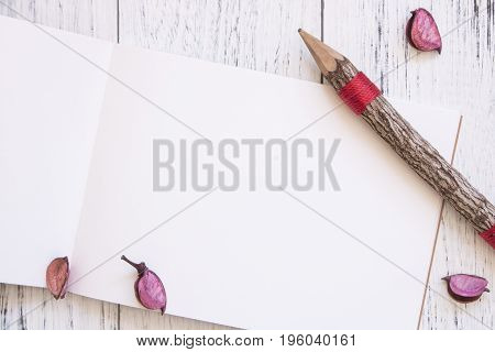 Stock Photography Flat Lay Vintage White Painted Wood Table White Note Book Pencil Flower Petals