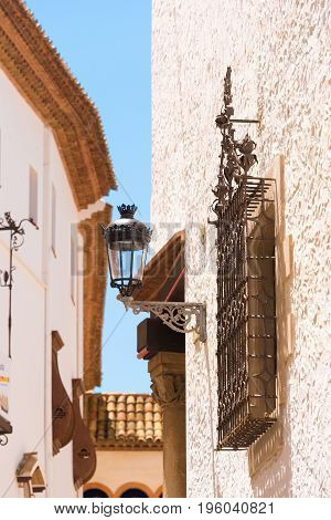 View Of The Wrought-iron Grille And Streetlight, Sitges, Barcelona, Catalunya, Spain. Vertical.