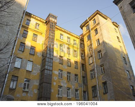 Large town house with yellow plastered walls