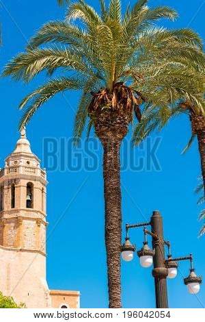 View Of The Tower Of The Church Of Sant Bartomeu And Santa Tecla In Sitges, Barcelona, Catalunya, Sp