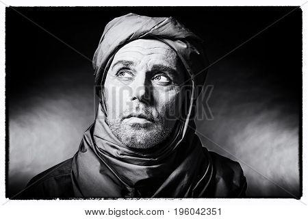 Vintage Black And White Photo Of Berber Man Wearing Turban. Studio Shot.
