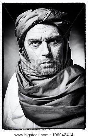 Vintage Black And White Photo Of Berber Man Wearing Turban With Robe. Studio Shot.