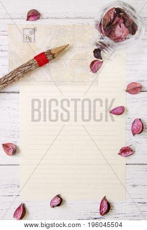 Flat Lay Stock Photography Purple Flower Petals Letter Envelope Paper Glass Bottle Wood Pencil