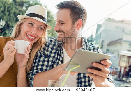 Two people in cafe enjoying the time spending with each other.