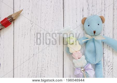 Stock Photography Flat Lay Vintage White Painted Wood Table Blue Bear Doll Holding Cotton Candy Penc