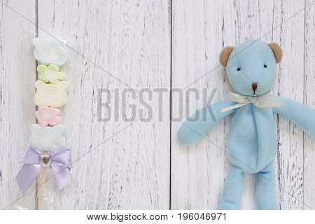 Stock Photography Flat Lay Vintage White Painted Wood Table Blue Bear Doll Cotton Candy