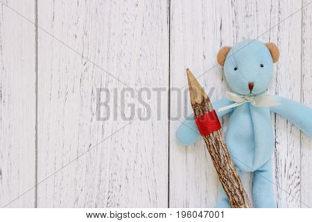 Stock Photography Flat Lay Vintage White Painted Wood Table Blue Bear Doll Holding Pencil