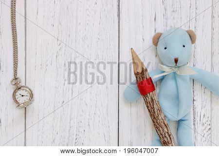 Stock Photography Flat Lay Vintage White Painted Wood Table Blue Bear Doll Holding Pencil Pocket Clo