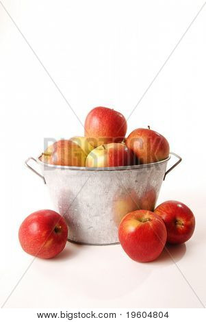 An isolated basket of delicious ripe apples