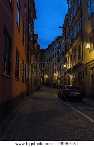 STOCKHOLM, SWEDEN - JULY 7, 2016: It is one of the old alleys of the Gamla Stan district on a summer night.