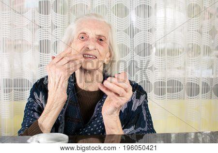 Senior Woman Applying Face Cream