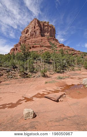 Lone Butte Rising above a Desert Arroyo near Sedona Arizona