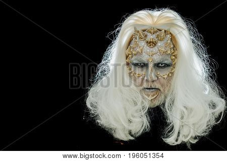 Demon Head With Grey Hair Isolated On Black