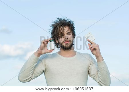 Man With Pill In Plastic Jar And Blister Pack