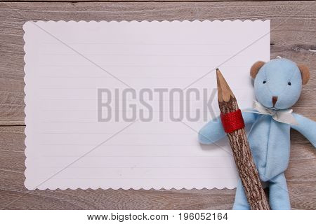 Stock Photography Flat Lay Template Wooden Plank Table White Letter Paper Blue Bear Doll Holding Pen