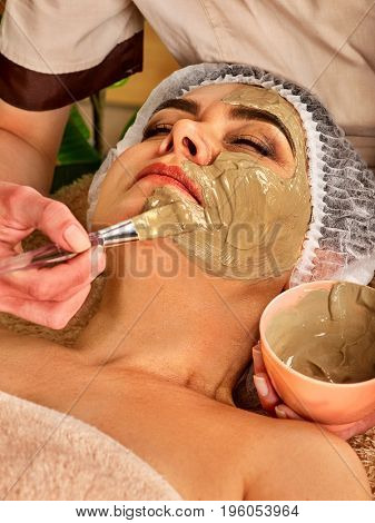 Collagen face mask. Facial skin treatment. Face of woman of elderly woman 50-60 years old receiving cosmetic procedure in beauty salon close up. The best curative clay for cosmetic masks.