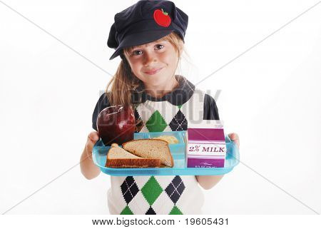 A cute young girl holding a school lunch tray