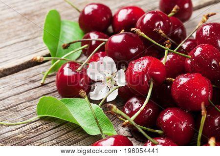 Fresh garden cherry on wooden table