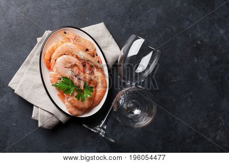 Fresh seafood on stone table. Shrimps. Top view with copy space