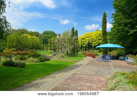 City Park in Mannheim, Germany. Resting place. Many flowers and trees.
