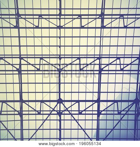 Lattice frame of vintage skylight window -  industrial architectural background.  Retro style filtered image