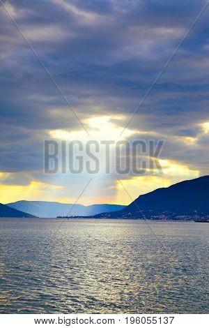 Water landscape with sunbeam, Boka Kotorska bay,  Montenegro. Copyspace composition