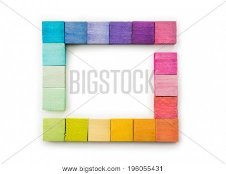 Colorful arrangement of wooden blocks arranged in a frame or rectangle. isolated on white.?Flat lay or top view.