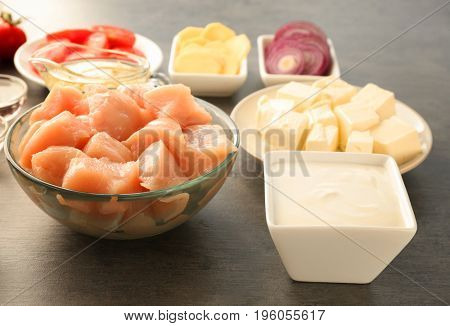 Ingredients for butter chicken on grey table