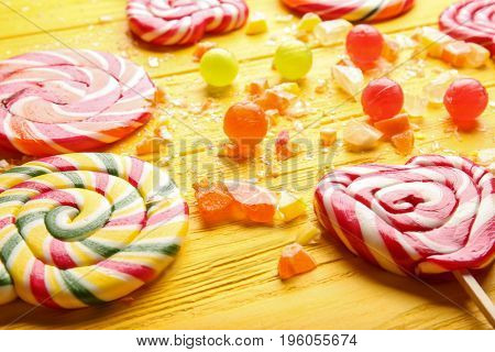Composition of delicious candies on wooden table