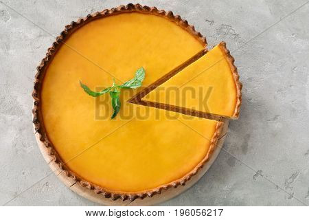 Delicious lemon pie on gray table