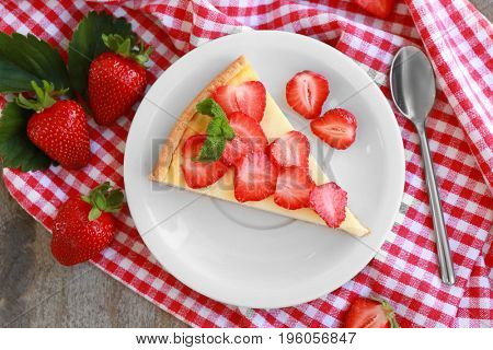 Piece of homemade cake with strawberries on plate