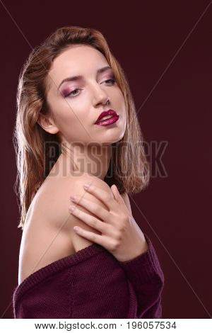 Beautiful stylish woman on color background