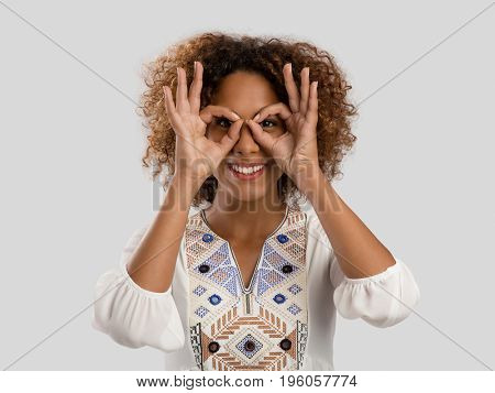 Beautiful African American woman making a silly face