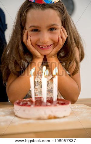 Shot of a happy young girl celebrating her birthday