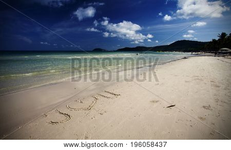 Love message on gold sand of a beautiful tropical beach