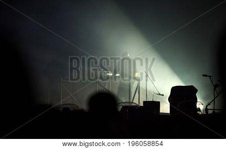 Music band silhouette, night entertainment, music festival