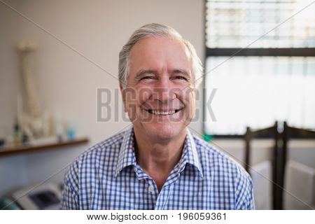 Close-up portrait of smiling senior male patient at hospital ward