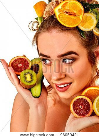Hair mask from fresh fruits on woman head. Girl with beautiful face hold ingredient for homemade organic skin and hair therapy. Concept of healthy and beauty hair and skin. Cosmetics against allergies