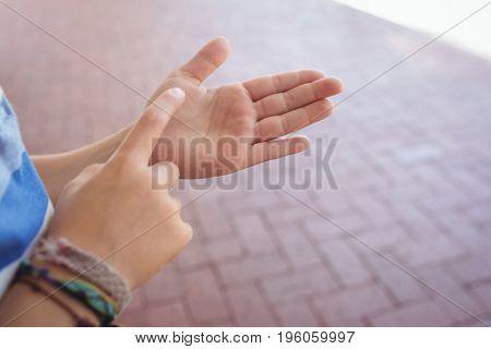 Cropped hands of student gesturing in corridor