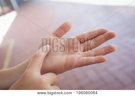 Cropped hands of child gesturing at corridor