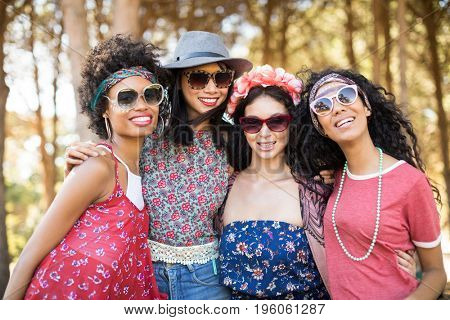 Portrait of happy female friends standing together at campsite