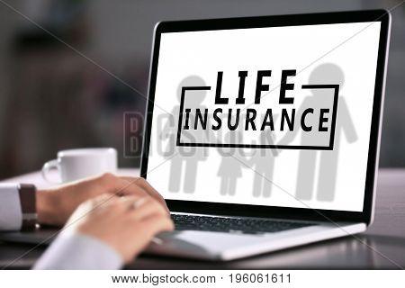 Man using laptop, closeup. Life insurance concept