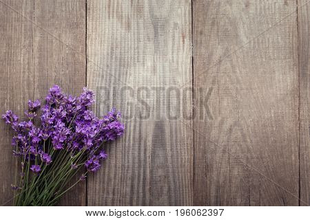 Bouquet of summer lavender on an old wooden background. (top view)