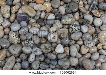 Sea stones. Stone background for tiles, facades of houses