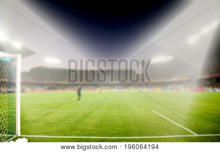 evening stadium arena soccer field with flood light - defocused background