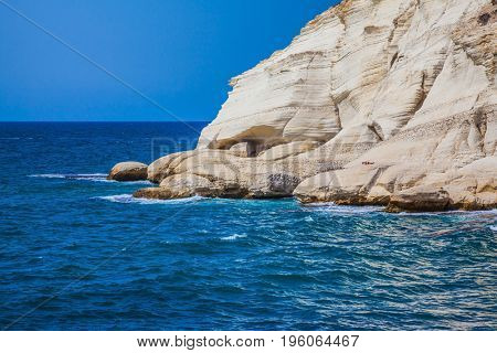 Rocks of white limestone form arches and grottoes on the shores of the Mediterranean Sea. Geological phenomenon in the north of Israel. The grottoes of Rosh Ha Nikra