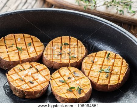 Baked batata on the frying pan.